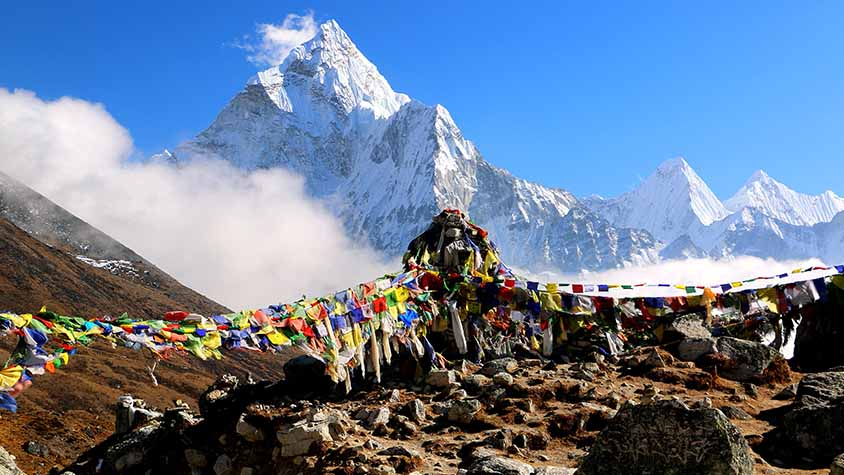 Views of Mt Everest with traditional Nepalese prayer flags