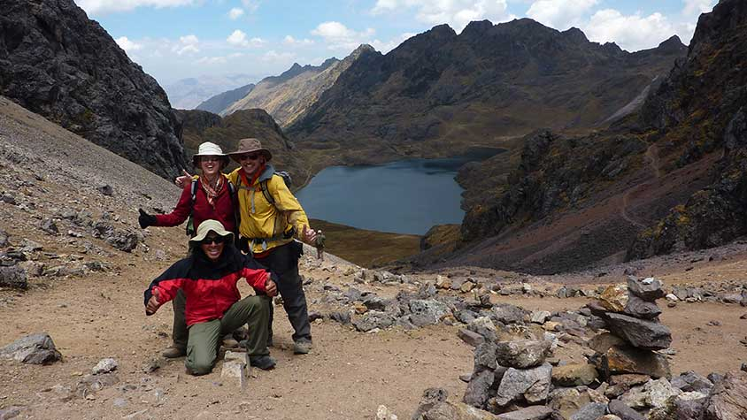 Happy hikers on top of the highest pass Ipsay Qasa - Peru's Lares Inca Trail