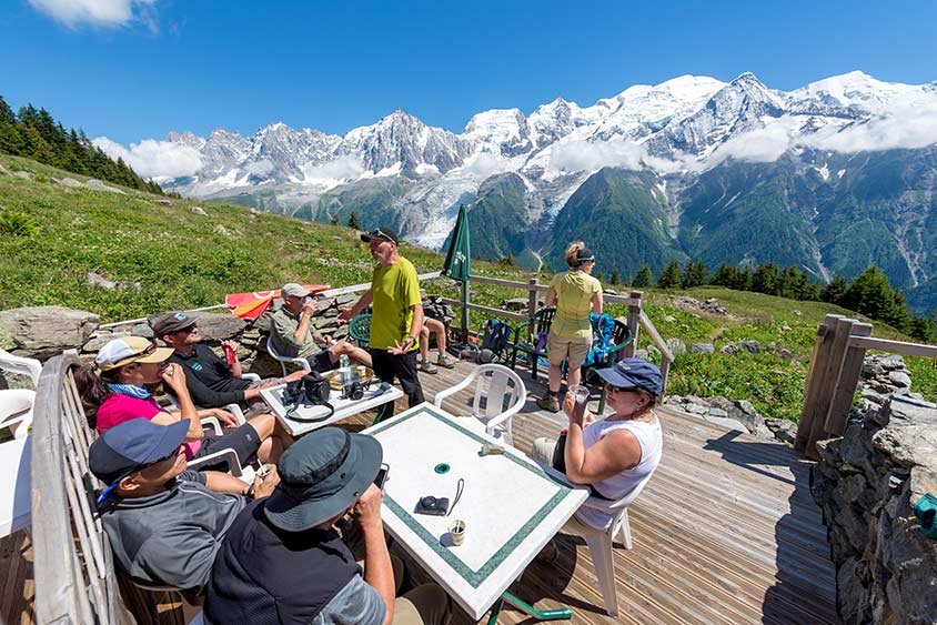 best time to hike the tour du mont blanc hikers rest with a drink overlooking mont de la saxe balcony region