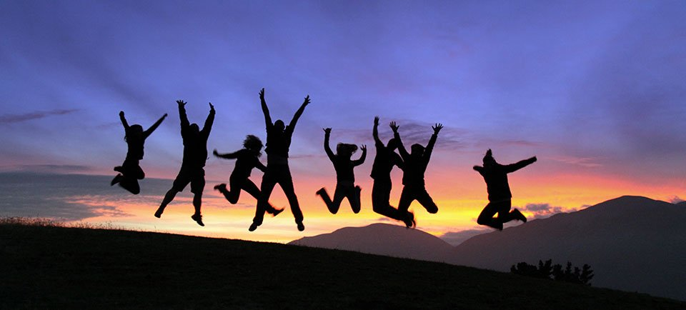 Active Adventures Club members jumping in the sunset