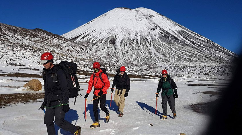 4 hikers on the Tongariro Crossing during Winter