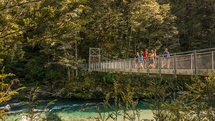 Hikers on a Routeburn Track Bridge